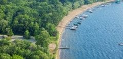 Aerial view of typical lakeshore with docks and boats in Minnesota