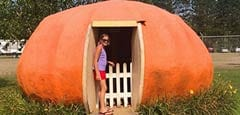 Girl standing in pumpkin house