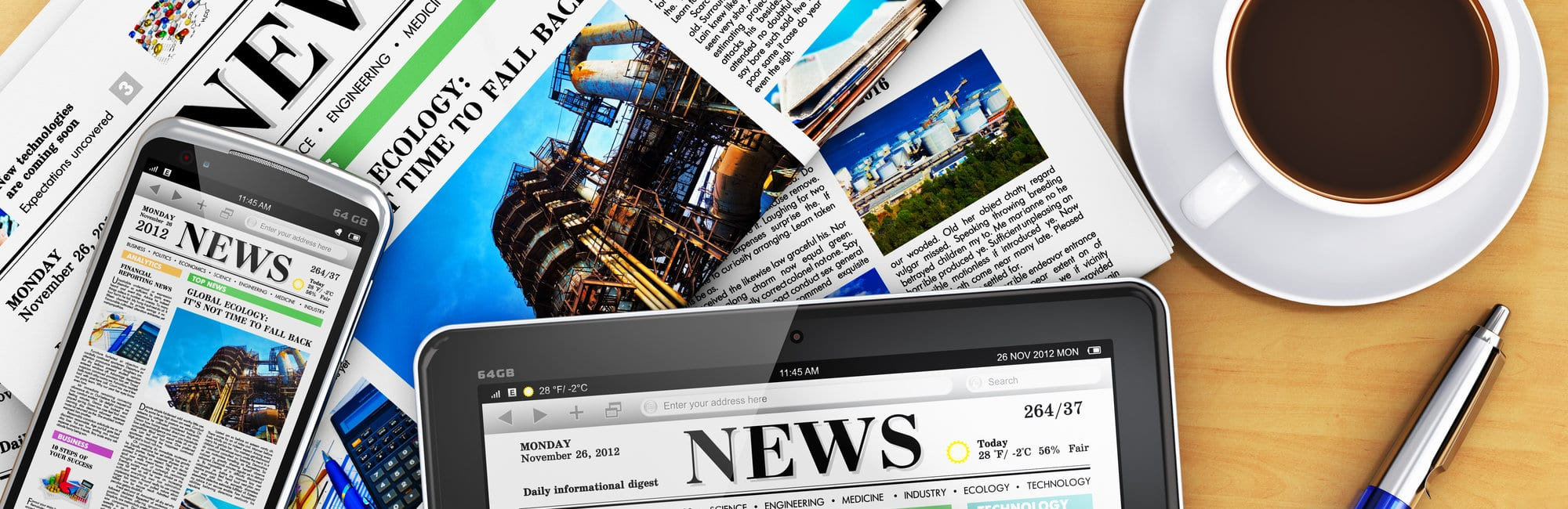 Creative business corporate work concept: tablet computer PC, modern black glossy touchscreen smartphone with news internet web site, stack of newspapers, cup or mug of fresh coffee and metal ballpoint pen on wooden office table
